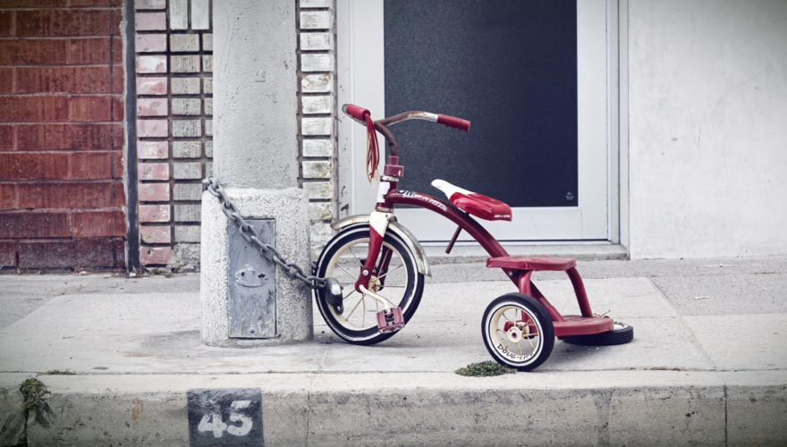 Chained up children's tricycle bike.