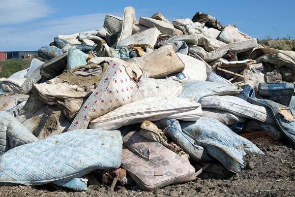 Old mattresses at a landfill dump