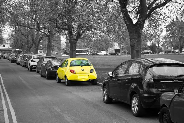 yellow car parked on street