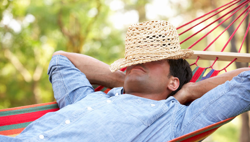 Man taking a nap in a hammock