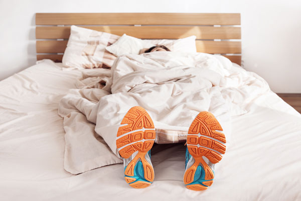 laying in bed with running shoes