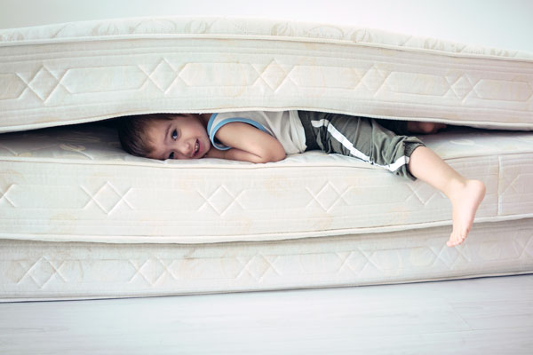 child underneath bed