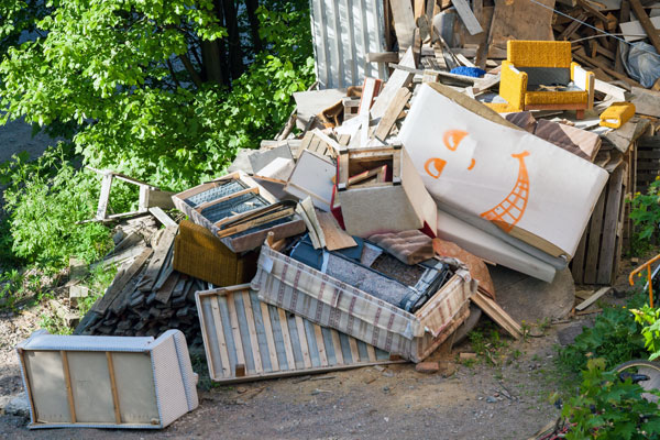 landfill full of old furniture