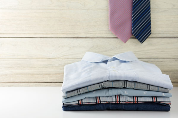 stack of ironed work clothes