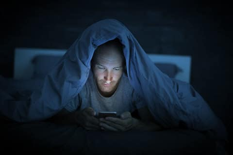 Scrolling on phone before bed