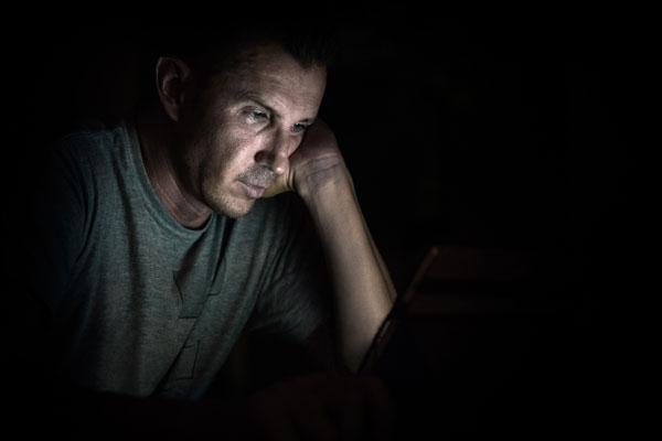 guy checking his social media on computer